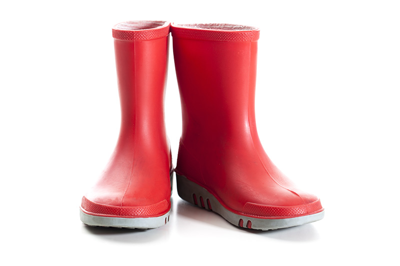 Pair of red rain boots. This image sold an EL on Shutterstock recently