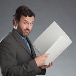 Business man sceptical analysis